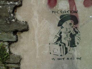 Migration-is-not-a-crime-banksy-streetart-stencil-